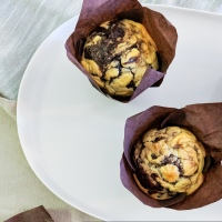 Chocolate Banana Muffins with Cream Cheese Swirl